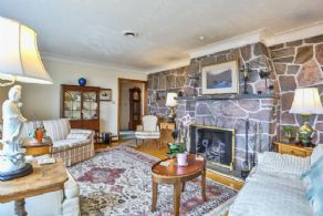 Living Room Stone Fireplace - Country homes for sale and luxury real estate including horse farms and property in the Caledon and King City areas near Toronto
