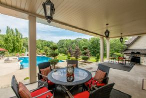 Covered Seating Area off Kitchen - Country homes for sale and luxury real estate including horse farms and property in the Caledon and King City areas near Toronto